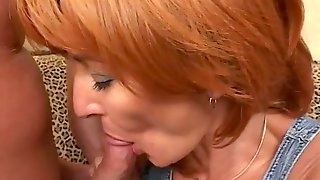 Redhead MILF with big tits gets fucked rough on a sofa