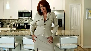 Red haired cougar Andi James is playing with her old jugs and stretched twat
