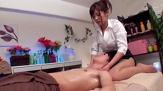 Stunning Japanese spread out wants to massage a friend's hard dick