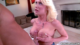 Busty fair-haired Riley Jenner jerking a hard dick with her boobies